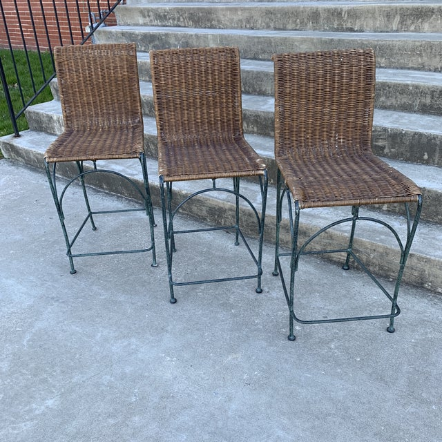 Heavy and solid iron bar stools with wicker seats. A couple small breaks to wicker, mostly just wear of the finish. Iron...