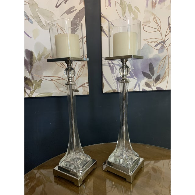 Instantly update your home or office decor with this candle holder made of a thick, twisted glass base with polished...