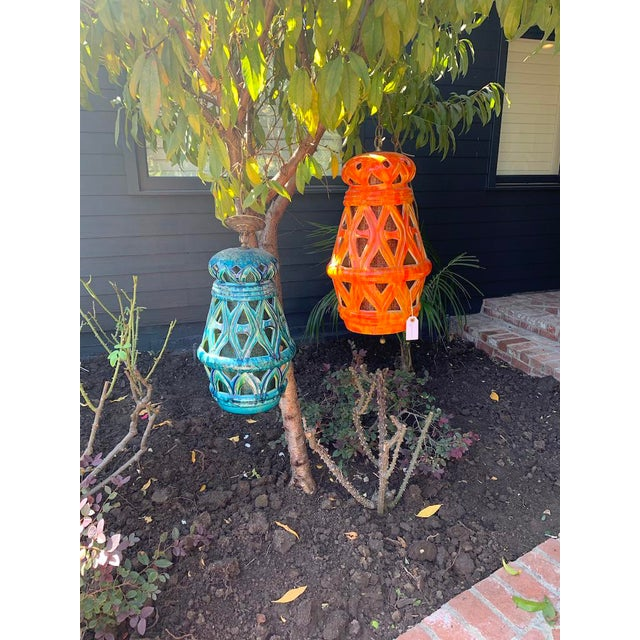 Mid-Century Tiki Style Ceramic Pendants. There is a fabric diffuser shade in side in coordinating colors. These are...