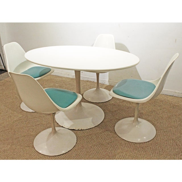 Mid-Century Danish Modern 5 Pc Saarinen-Style Oval White Tulip Dining Set Offered is a 5 piece dining set, similar to the...