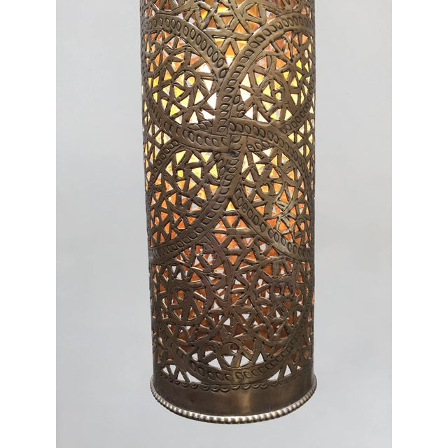 Pair of Moroccan brass pendants lights in cylinder form. Nice handcrafted lanterns with Moorish geometric filigree...