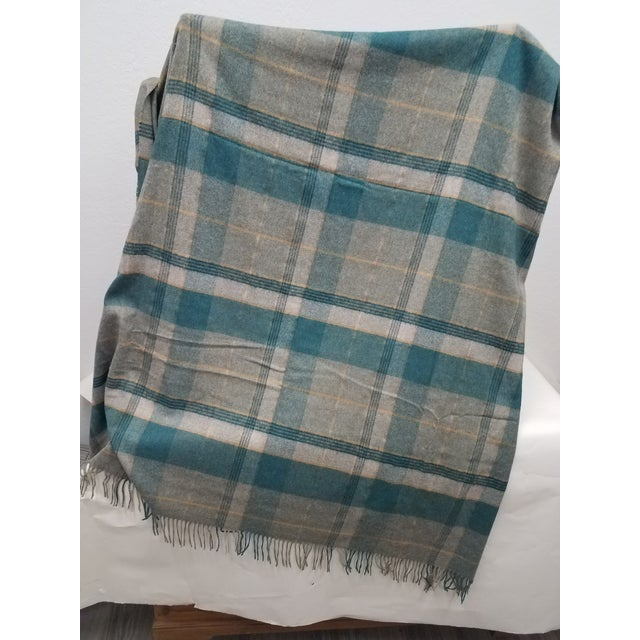 Merino Wool Throw Light Aqua Blues Grey Plaid - Made in England A versatile throw in a plaid design made from soft 100%...
