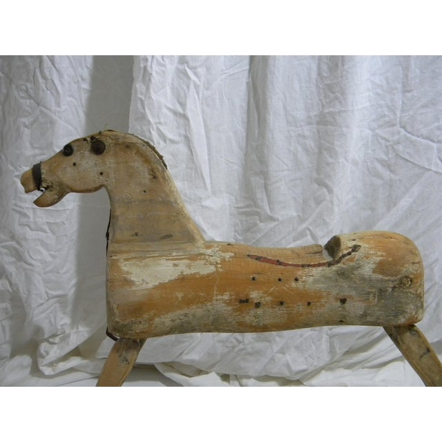 Antique rocking horse. This is a solid body hand carved horse with paddle legs and long stretchers for rocking. Horse no...