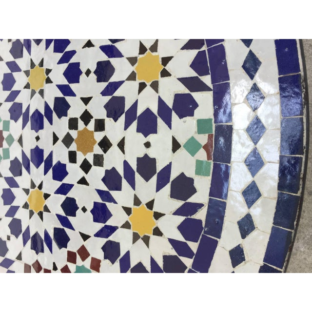 Great Moroccan mosaic tile table, delicately handcrafted in Fez with traditional Islamic Moorish geometric design in...