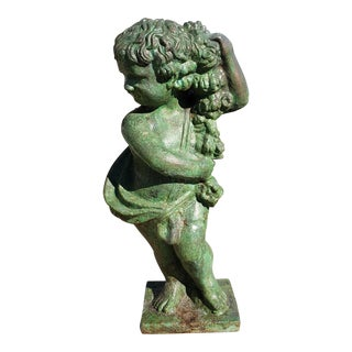 Circa 1880 English Victorian Bronze Patinated Cast Iron Putto Statue For Sale