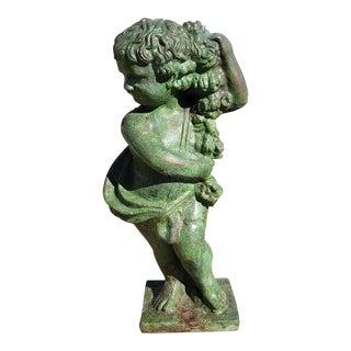 English Victorian Bronze Patinated Cast Iron Putto Statue, Circa 1880 For Sale