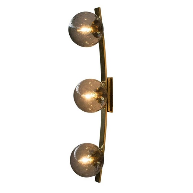 Italian Murano wall sconce shown in smoky Murano glass globes with hand blown bubbles within the glass in Bollicine...