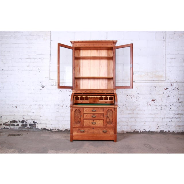 Traditional 19th Century Eastlake Victorian Carved Walnut and Burl Wood Cylinder Desk With Glass Front Bookcase For Sale - Image 3 of 13
