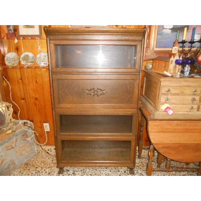 Gunn early 1900's quarter sawn oak lawyers' stacking bookcase with secretary desk. Secretary has 4 cardboard receipt...