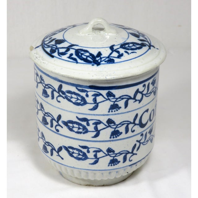 An Antique American primitive stoneware Kitchen Coffee Storage Canister - Jar. It has extensive blue decorations that are...