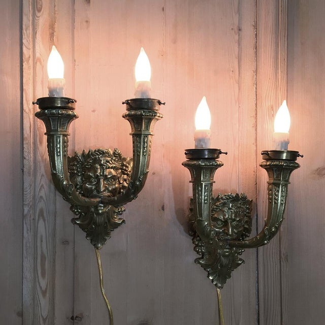 Pair Antique Bronze Bacchus Electrified Wall Sconces are perfect for adding incredible detailing to your interior...