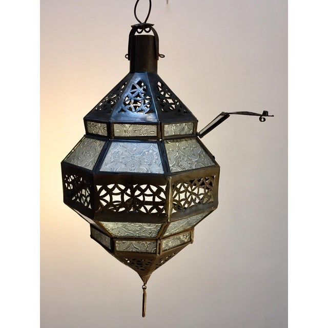 Moroccan metal and clear frosted glass lantern. Moroccan lantern in octagonal shape with rust color metal finish and clear...