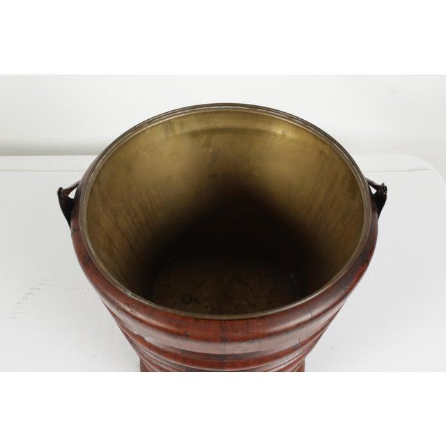A Dutch Biedermeier tea bucket or teestoof C.1830, which was originally used for keeping tea-kettles warm. The kettle...