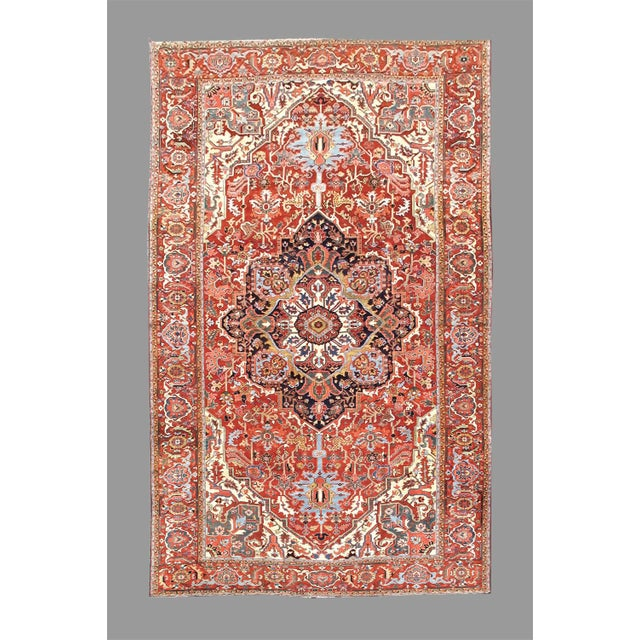 Elaborate detailed drawing and an elevated use of ivory for contrast are both special features of this regal Heriz carpet...