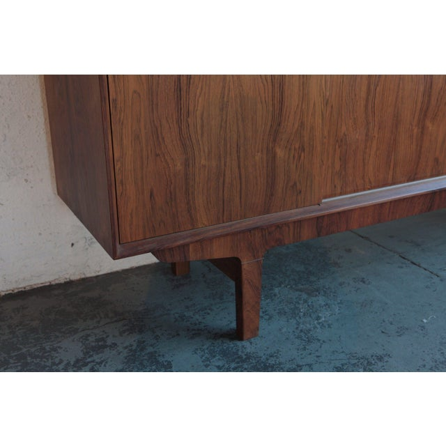 With a variety of utile shelving options within, this credenza is well-designed and beautiful. The piece was created in...