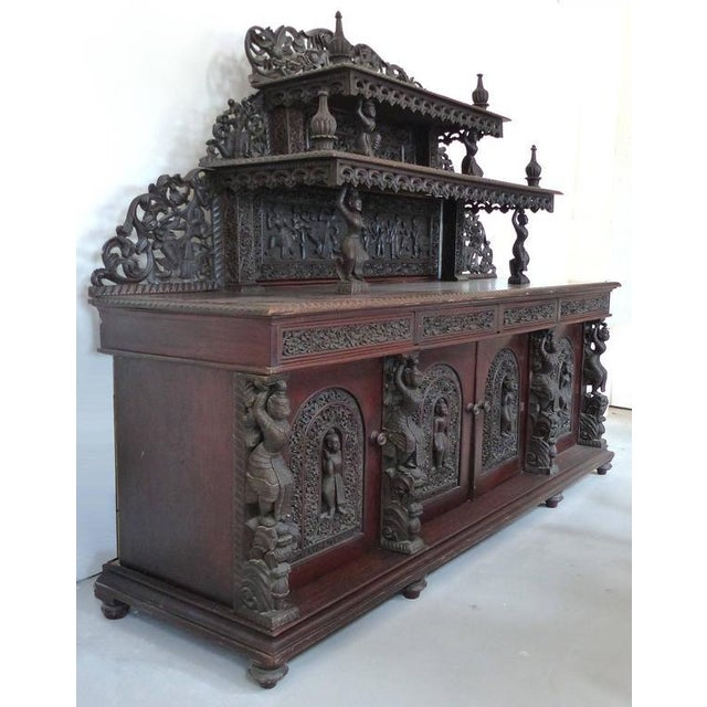 This is a grand scale and finely detailed Burmese 19th century carved rosewood Anglo-Indian sideboard. Two ornate tiers...