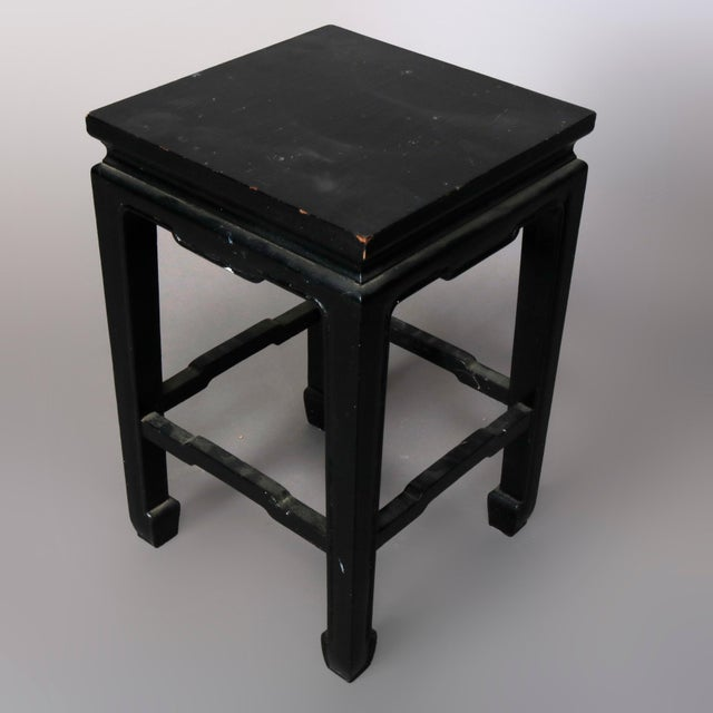 A vintage set of four matching Chinese side stands offer black lacquered wood construction with square tops surmounting...
