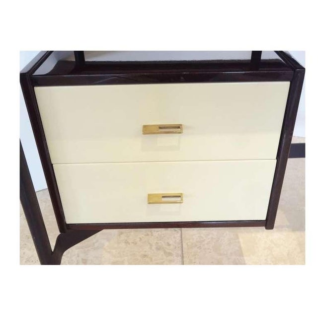 Mid-century writing desk featuring a frame in blackened metal with high polished brass sabots, two white lacquered...