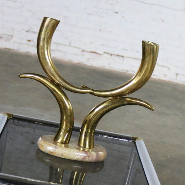 Handsome brass horn shaped or tusk shaped candle holder on oval stone base. This piece is in wonderful vintage condition....