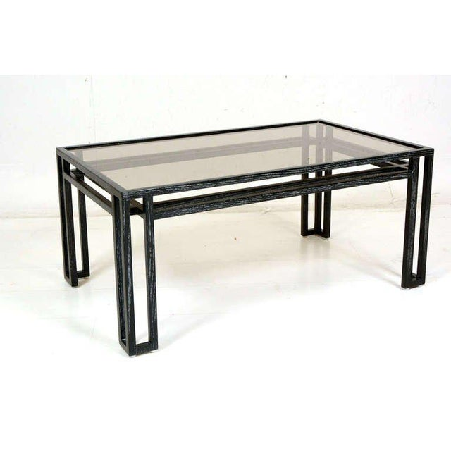 For your consideration a Mid-Century Modern coffee table made of solid oakwood. Very clever and unique design. Smoke glass...