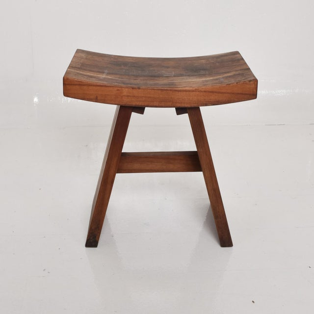 A custom stool in walnut. Unique construction. Sculptural shape. Unmarked, no information on the maker. Dimensions: 18...