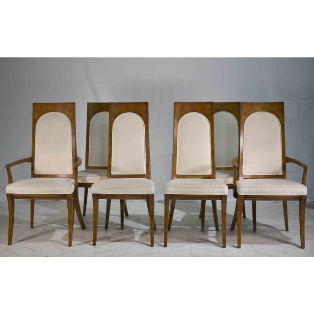 Fabulous set of six Hollywood Regency style dining chairs by Mastercraft. They are made with exotic amboyna burl veneer...