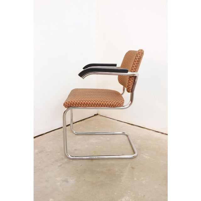 The iconic cantilever chair, designed by Marcel Breuer for Thonet. Made of chrome plated tubular steel, foam padding, and...