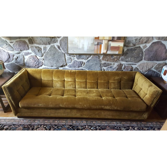 Trend alert - gold velvet! This sofa has lovely lines, walnut plinth base and a tufted cushions. The deep and low cut...