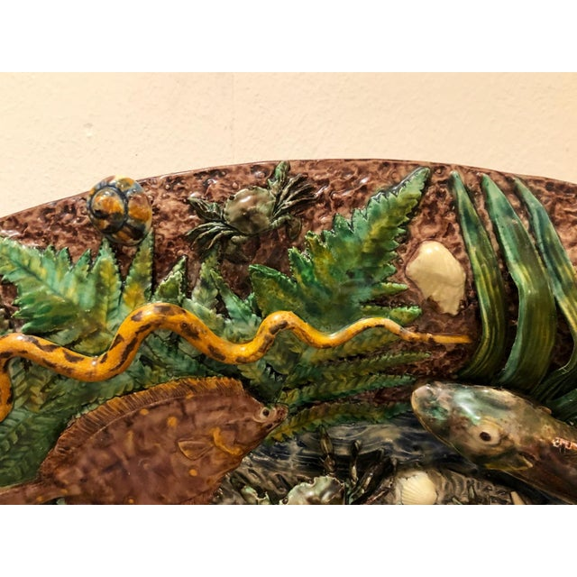 A large 19th Century French Palissy platter, depicting fish and sea life, signed T Sergent, circa 1880.