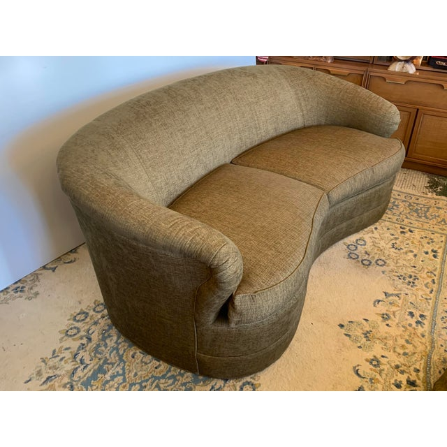 An outstanding traditional sofa by Drexel Heritage with a modern design. This plush sofa features a kidney-like silhouette...