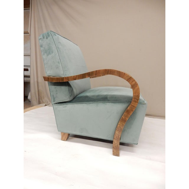 A pair of 1930s upholstered armchairs. Very nice curved walnut veneered arms. Extremely comfortable chairs.