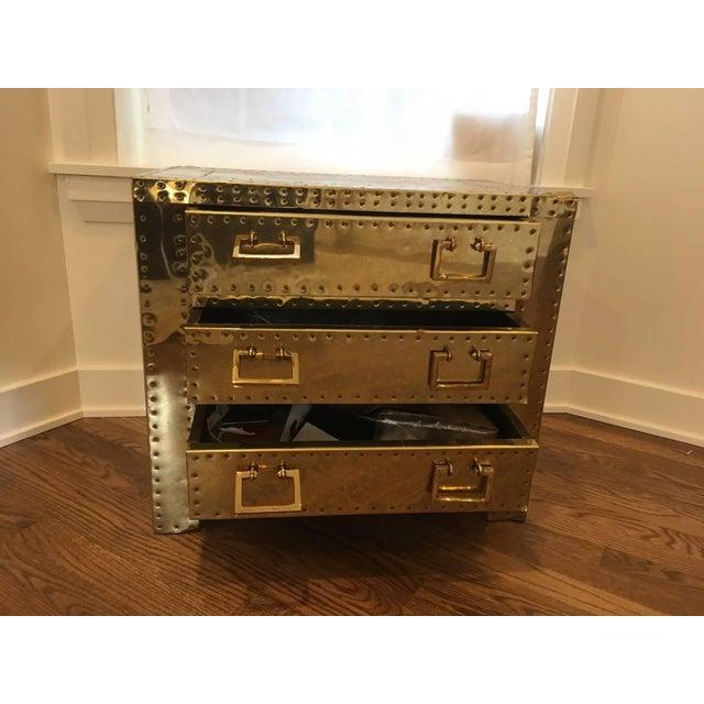 Sarreid of Spain Ltd. brass three-drawer chest with hand-hammered copper clad studs. This piece has plenty of storage and...