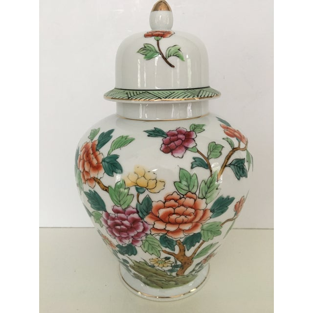 Lovely, multicolored, chinoiserie, porcelain lidded urn from the mid-century. This was produced in Japan by Norleans. It...