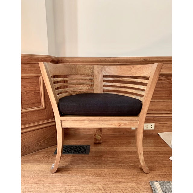 Great, simple natural wood corner chair with removable black linen seat cushion. The perfect, understated, accent for a...