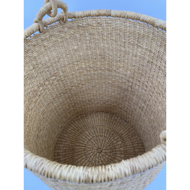 """You can never have too many baskets. This sturdy upright """"hamper"""" gives that ever-mounting pile of dirty clothes a lovely..."""