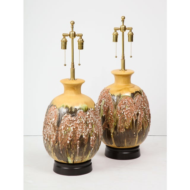 Wonderful pair of extra large Italian ceramic lamps with a beautiful textured Volcanic glazed finish. The lamps have been...