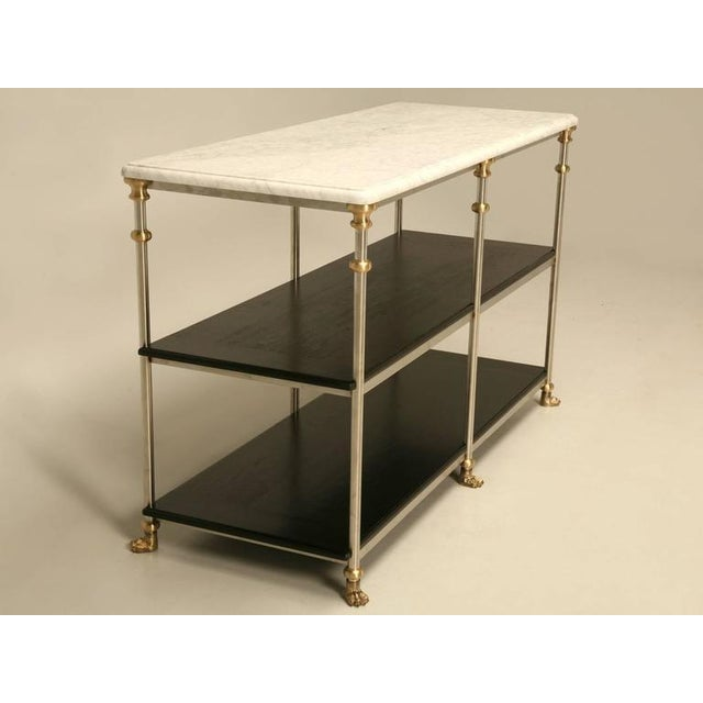 From our exclusive Old Plank Collection, this particular kitchen island was made from stainless steel and brass, then...