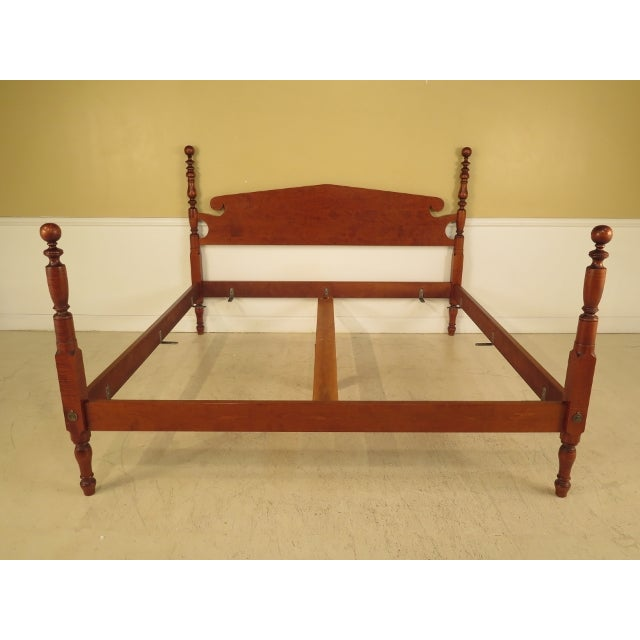 This Eldred Wheeler king-size bed features high-quality, bolt-through-rail construction and is crafted of solid tiger...