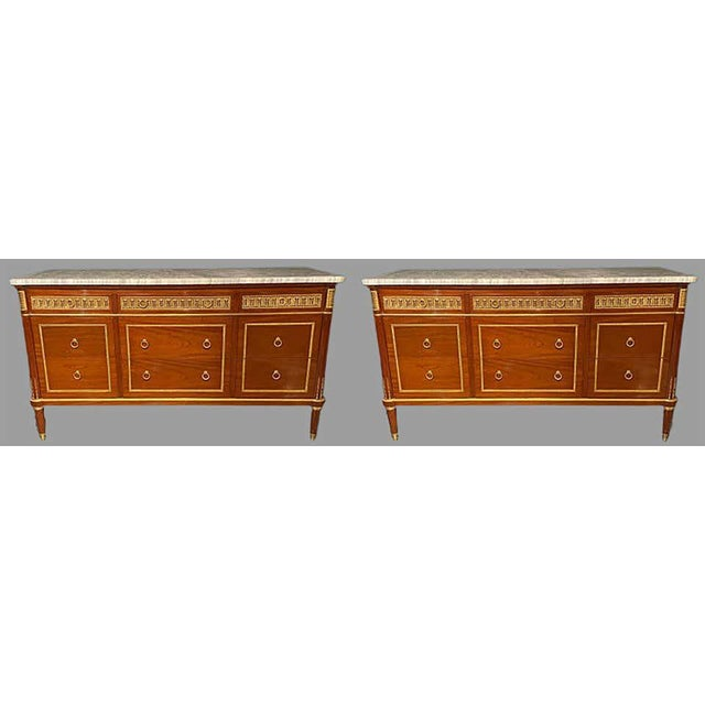 Pair of monumental Louis XVI style marble-top commodes in the Maison Jansen fashion. These impressive and finely...
