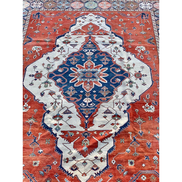 This is a Persian Serapi rug. The piece was handmade in the 1990s.