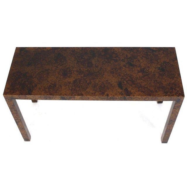 Mid-Century Modern tortoise medium gloss finish console table.