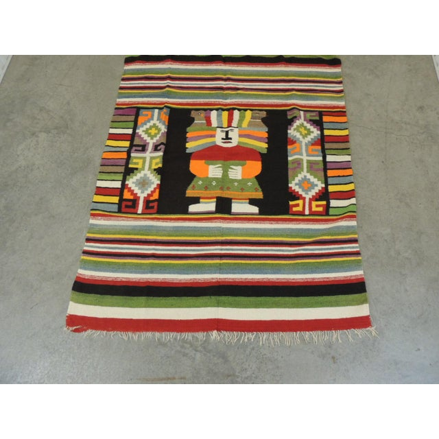 Large vintage Peruvian warrior throw with colorful stripes. Large enough to use as a blanket on a twin bed. In shades of...