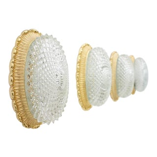 One of Two Oval Wall Sconces With Textured Glass and Gilded Metal by Limburg For Sale
