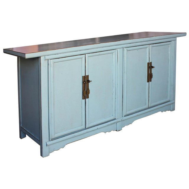 Baby blue sideboard with crackled lacquer finish has four doors and interior drawers. Elegant buffet can be used as a...