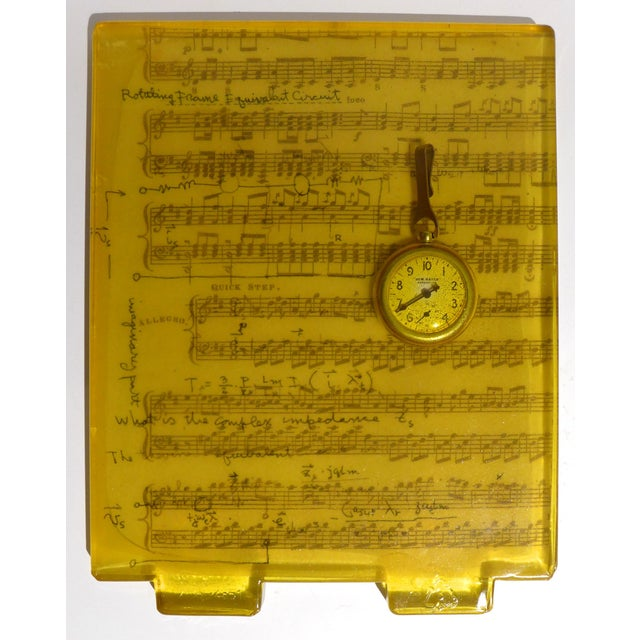 Untitled artwork of cast silicone with sheet music and pocket watch by Pittsburgh area artist Adrienne Heinrich, executed...