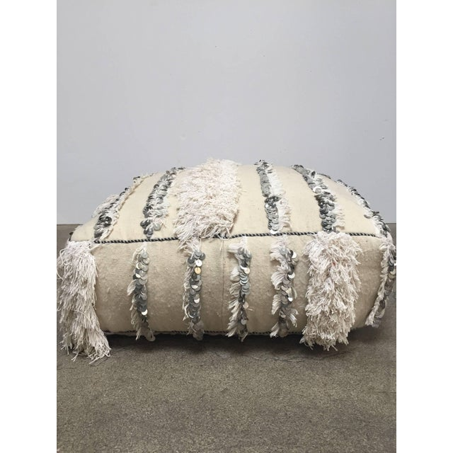 This handcrafted vintage Moroccan tribal floor pillow or pouf is made from a traditional handwoven white wool and cotton...