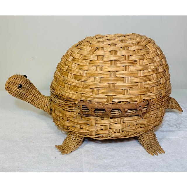 Great wicker turtle storage box, circa 1970. Lid opens and is attached on one side. Lovely details, features glass eyes....