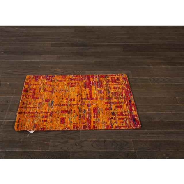 Hand-knotted Modern Indian rug made with re-purposed traditional sari silk. This piece has great colors, it would be...
