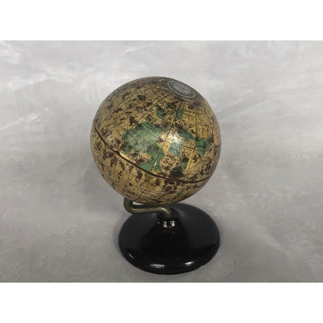 This small vintage world globe bank overlaid with Denoyer Geppert paper map gores is a scarce find. The Vintage world...