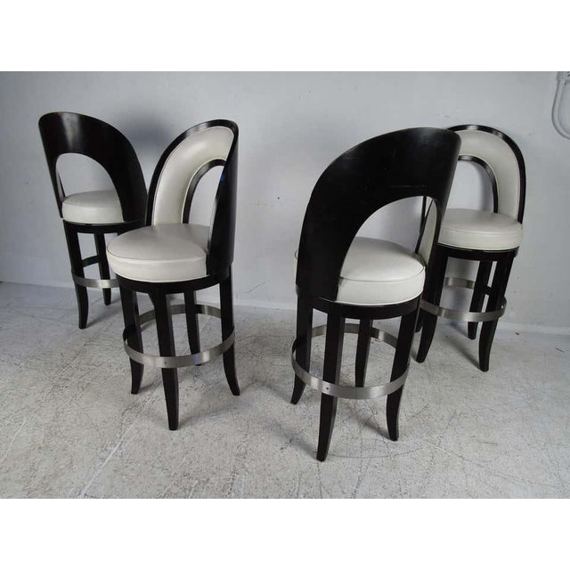 This stunning set of four vintage modern Italian barstools feature a two-tone black and white design. The overstuffed...